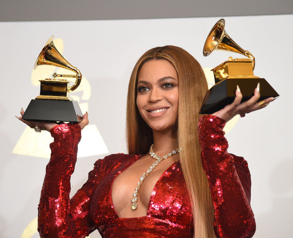(FILES) This file photo taken on February 12, 2017 shows singer Beyonce  with her Grammy trophies in the press room during the 59th Annual Grammy music Awards in Los Angeles, California.  (Robyn Beck / Getty Images