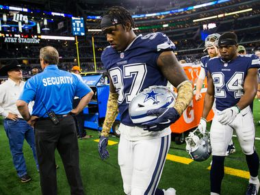 Dallas Cowboys defensive end Taco Charlton (97) and cornerback Chidobe Awuzie (24) leave the field after a 28-14 lost to the Tennessee Titans on Monday, November 5, 2018 at AT&T Stadium in Arlington, Texas.