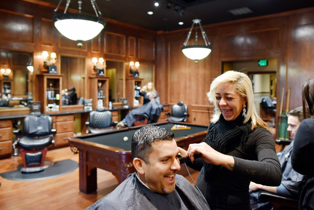 Victor Figueroa, 42, of Dallas, has his hair cut by stylist Rita Williams at the Boardroom salon for men, at the Lovers Lane location in Dallas on Dec. 9, 2016. Figueroa has been a frequent client of the salon for a year.