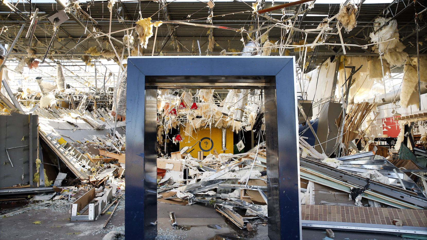The interior of Interabang Books was demolished by a tornado in the Preston Royal shopping center in Dallas on Monday, Oct. 21, 2019.