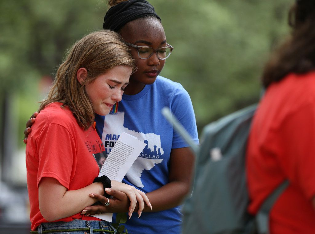 Danika McLeod, 17, sister of Kyle McLeod, who was killed in the Santa Fe High School shooting, is consoled by Cera Perry-Johnson, 17, of Plano West High School during a National Die-In event outside Sen. Ted Cruz's Dallas office on Tuesday. The National Die-In was created by students nationwide calling for stricter gun control following mass shootings.