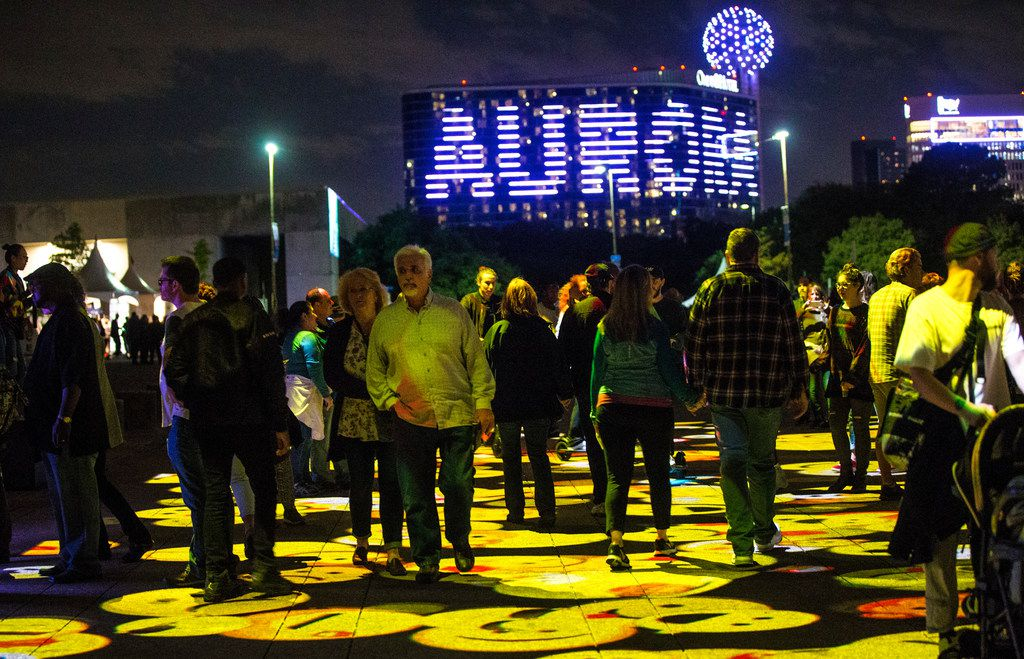 People walk through Digital Icons by Miguel Chevalier during Aurora in Dallas on Nov. 3, 2018. The free art exhibition focuses on on light, video and sound art.