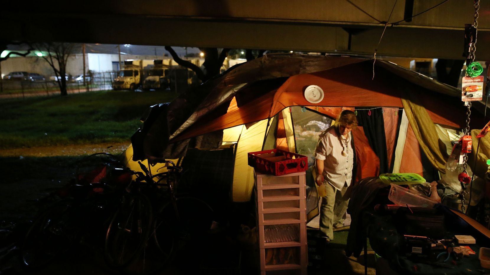 Rochelle Aslin, a Tent City resident of about three months, restocks the makeshift convenience store she manages at the homeless encampment. (Andy Jacobsohn/Staff Photographer)