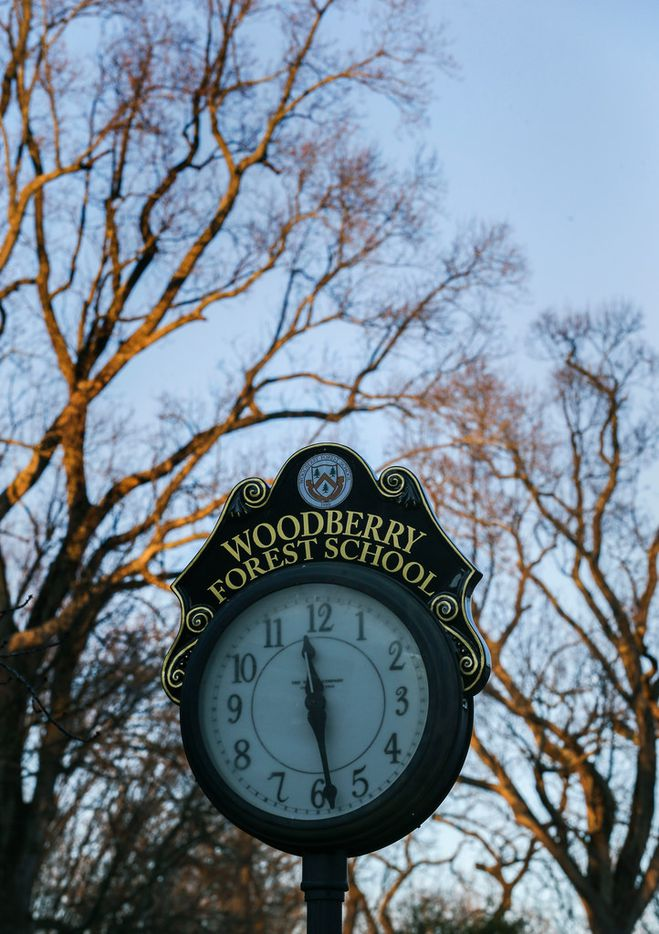 A clock is seen in a common area as the sun descends at Woodberry Forest School.