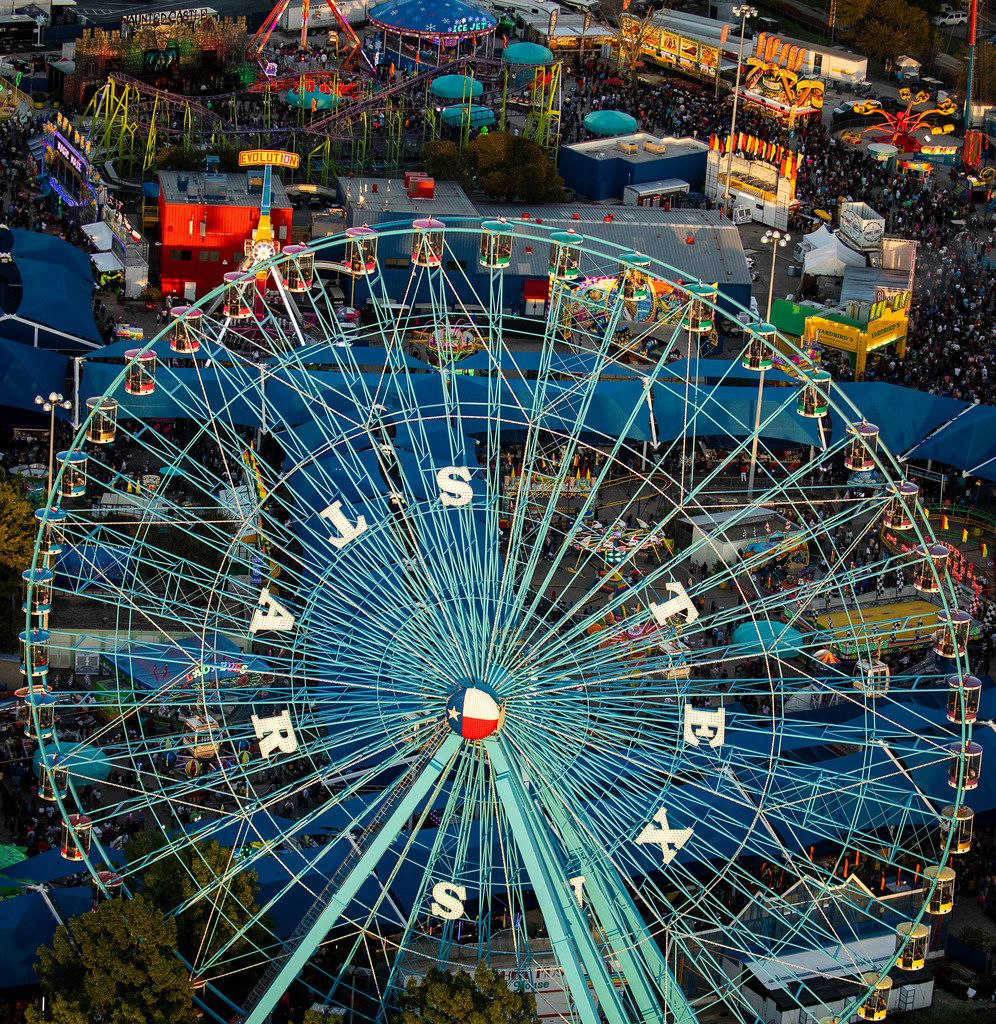 Crowds fill the midway at the State Fair of Texas in Fair Park on Saturday, Oct. 20, 2018, in Dallas. The fair ends on Sunday.