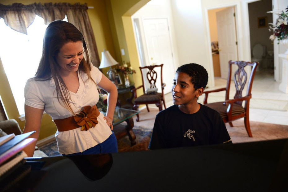 Roman Scott, 11, gets instruction from his piano teacher, Megan Maxwell, at his home in Cedar Hill. (2013 File Photo/Staff)