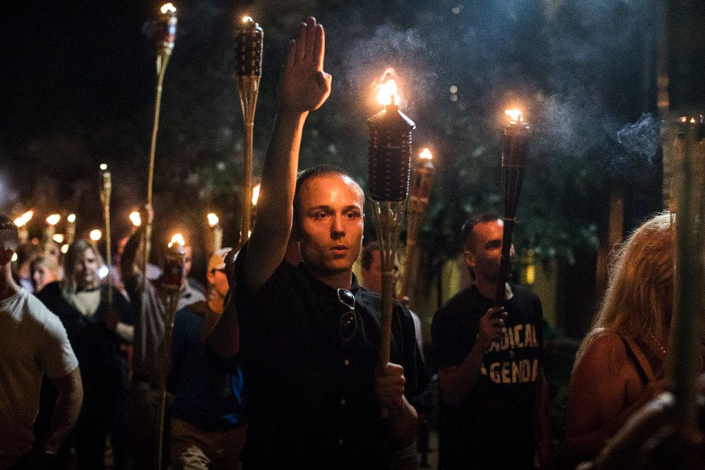 Torch-bearing white nationalists rally around a statue of Thomas Jefferson near the University of Virginia campus in Charlottesville on Friday night. Following violent confrontations on Saturday, a car plowed into a crowd of counter-protesters, killing one and injuring at least 19.