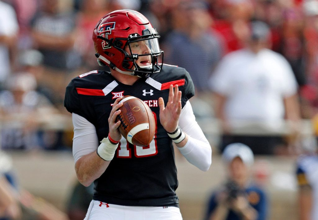FILE - In this Saturday, Sept. 29, 2018, file photo, Texas Tech's Alan Bowman (10) drops back to pass during the first half of an NCAA college football game against West Virginia in Lubbock, Texas.  (AP Photo/Brad Tollefson, File)