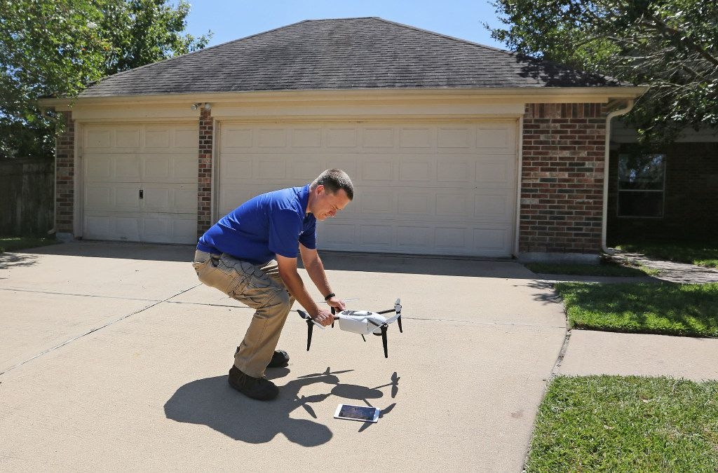 Farmers Insurance claims representative Brent Hazen gets ready to use a drone to make a record of the damage done by Hurricane Harvey on Doyle Court in Missouri City, Texas, a suburb of Houston, on Thursday, September 7, 2017. (Louis DeLuca/The Dallas Morning News)