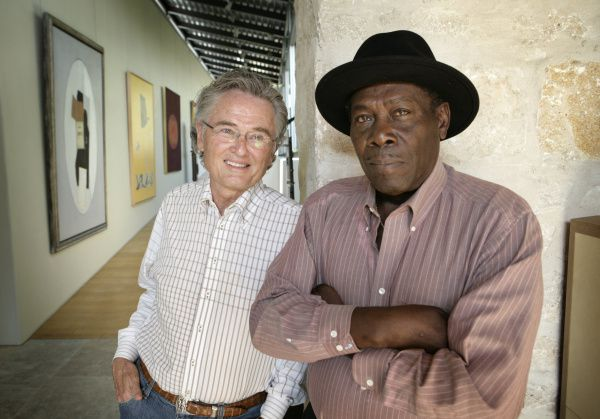 """Denver Moore (right) rose from the streets of Fort Worth to become an inspirational author and speaker after he was befriended by art dealer and soup kitchen volunteer Ron Hall. The pair's book """"Same Kind of Different As Me"""" made the New York Times best-seller list."""