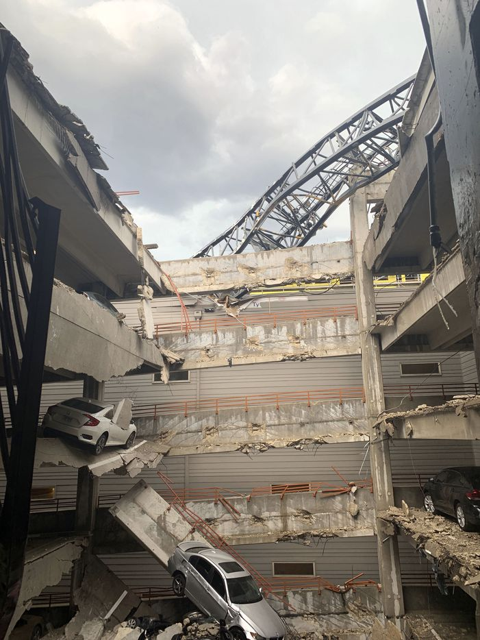 Injuries were reported after a crane fell into the Elan City Lights apartment building and parking garage in Old East Dallas close to downtown, as a severe storm passed through Dallas on Sunday afternoon, June 9, 2019.