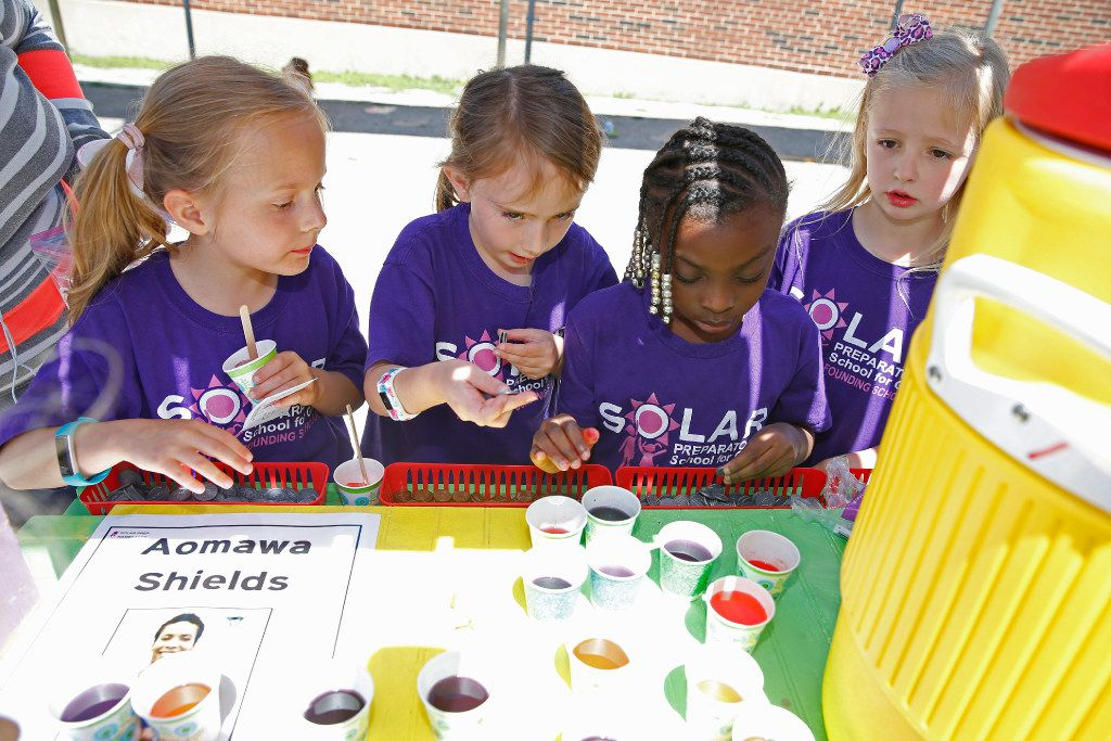 "From left: Claire Wickiser, 7, Micah Moss, 7, Kaylon Giddens, 7, and Riley Deal, 7, counted change from the Aomawa Lemonade stand as a part of ""project-based learning"" at Solar Prep Elementary in Dallas on May 5, 2017."