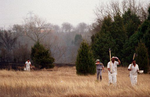 Inmates from the Hutchins State  Jail walk out of a 100 acre grass fire on Malloy Bridge Road near  Interstate175. From left are: Roland Esquivel, field boss Roy  Storie, Elvin Stephens, and Anthony Spencer.