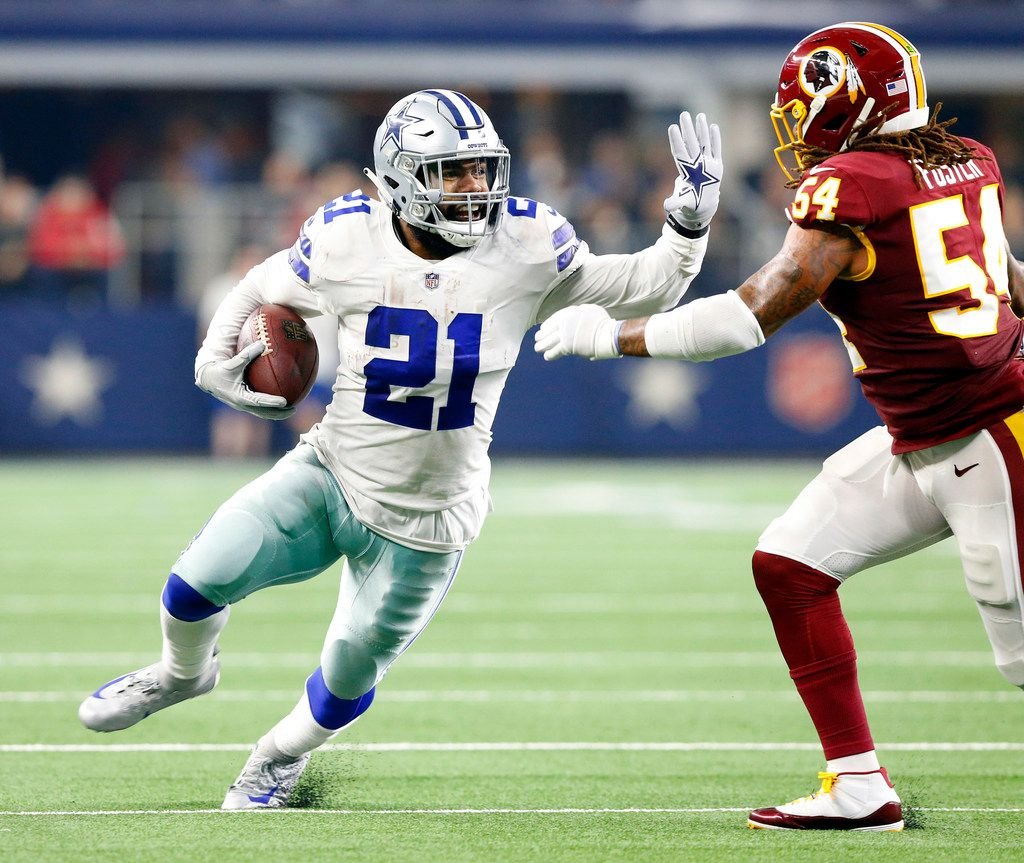 FILE - Cowboys running back Ezekiel Elliott (21) rushes to the outside as Washington Redskins inside linebacker Mason Foster (54) gives chase during the second quarter at AT&T Stadium in Arlington, Texas, Thursday, November 22, 2018. (Tom Fox/The Dallas Morning News)
