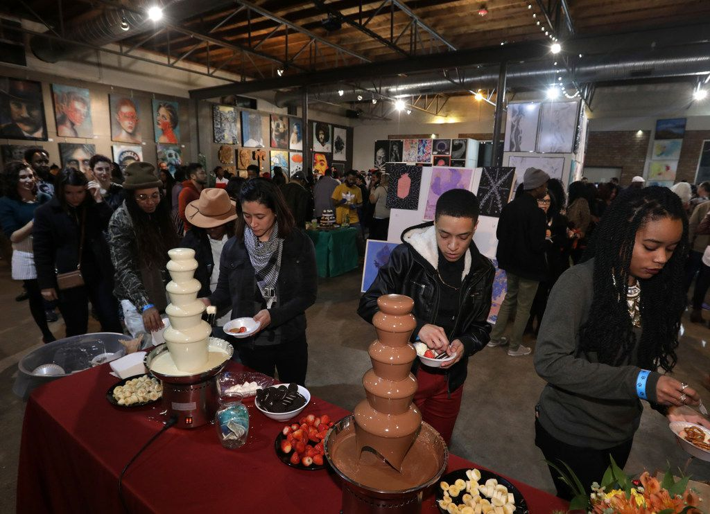 Guests take in the sights, sounds and flavors of the Chocolate and Art Show at Lofty Spaces in 2018.