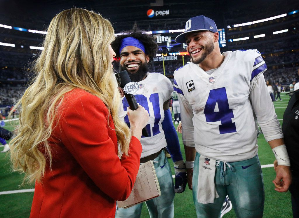 Dallas Cowboys quarterback Dak Prescott (4) and Dallas Cowboys running back Ezekiel Elliott (21) are all smiles as they're interviewed by ESPN personality Erin Andrews following their NFC Wild Card win over the Seattle Seahawks at AT&T Stadium in Arlington, Texas, Saturday, January 5, 2019. The Cowboys won, 24-22.