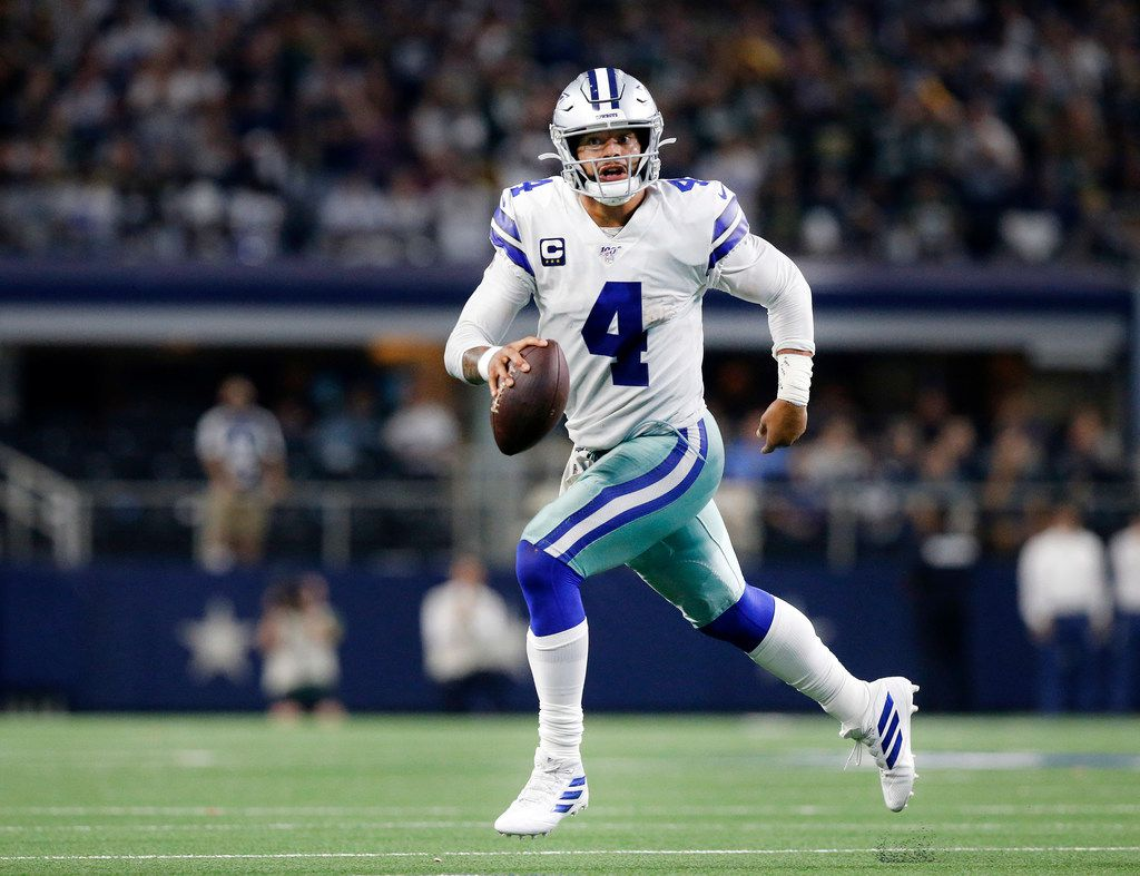 Cowboys quarterback Dak Prescott (4) rolls out looking for a pass in the fourth quarter against the Green Bay Packers at AT&T Stadium in Arlington, Texas, Sunday, Oct. 6, 2019.