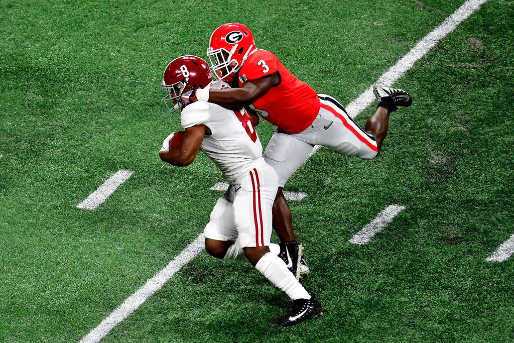 ATLANTA, GA - JANUARY 08:  Josh Jacobs #8 of the Alabama Crimson Tide is tackled by Roquan Smith #3 of the Georgia Bulldogs after a catch during the first quarter in the CFP National Championship presented by AT&T at Mercedes-Benz Stadium on January 8, 2018 in Atlanta, Georgia.  (Photo by Scott Cunningham/Getty Images)