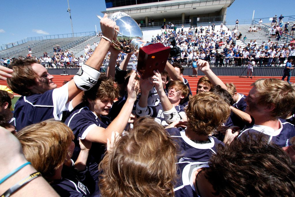 Episcopal School of Dallas lacrosse players celebrate as they raise the championship trophy and reflect on their successful season following their 9-6 victory over Highland Park. The two teams played in the THSLL Division l state championship game at 1:00 pm at Ron Poe Stadium in McKinney on May 12, 2019.  (Steve Hamm/ Special Contributor)