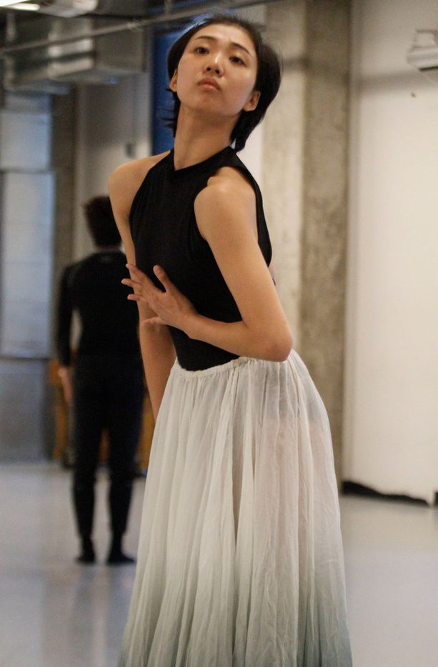 Beijing Dance Theater company members Feng Linshu, foreground, and Zheng Jie rehearse Beyond the Smoke, a new work by BDT artistic director Wang Yuanyuan, commissioned by Dallas presenter TITAS for its Command Performance gala, which was held May 5.