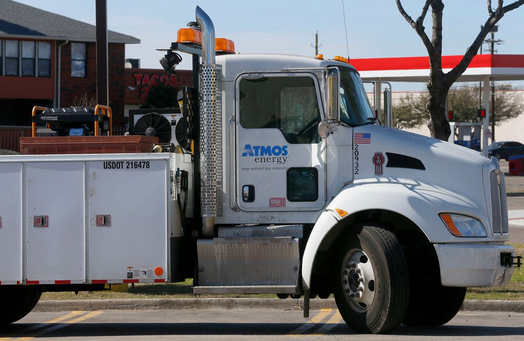 An Atmos Energy utility truck is parked near the construction site on Webb Chapel Road in Dallas on March 7, 2018.
