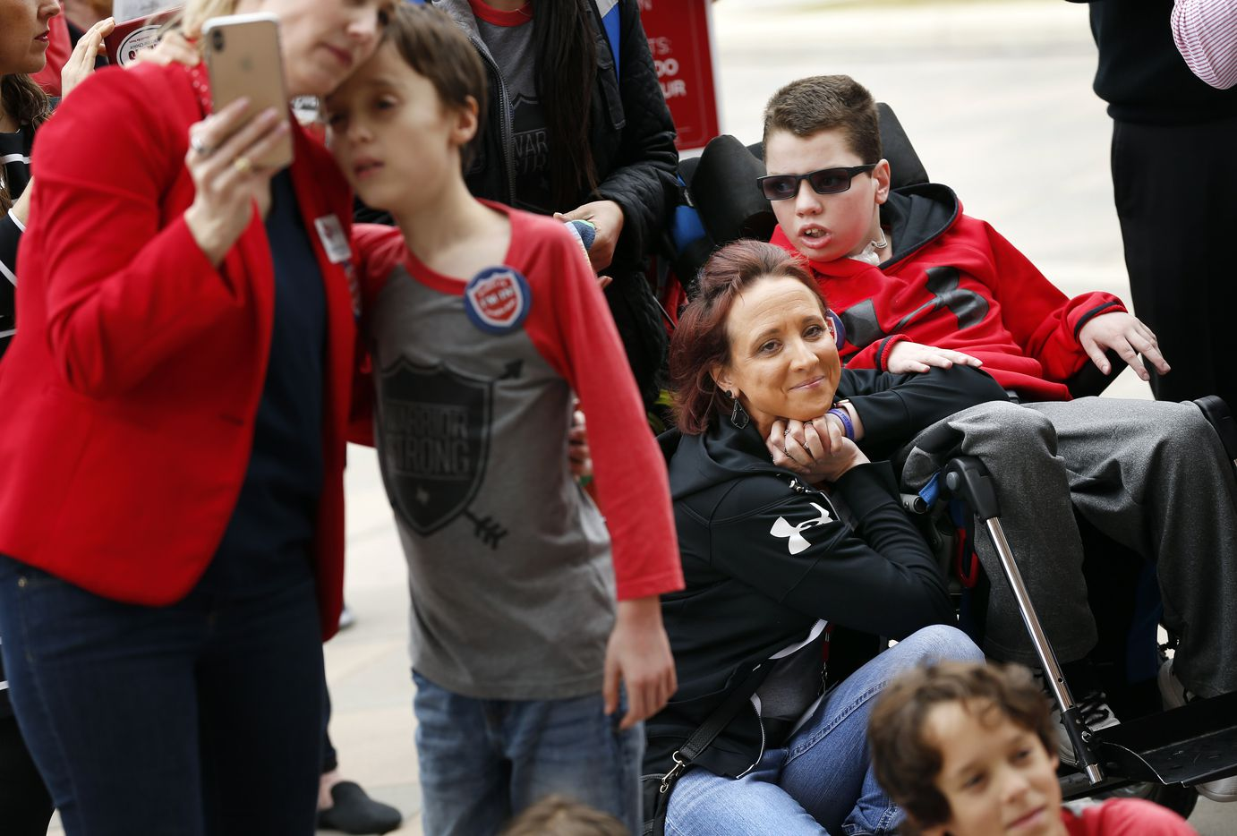 Crystal Brown (right) of Buda, Texas and her 12 yr-old medically fragile son Braden Brown listen to legislators speak at a Protect Fragile TX Children rally outside the Texas State Capitol, Tuesday, February 26, 2019.