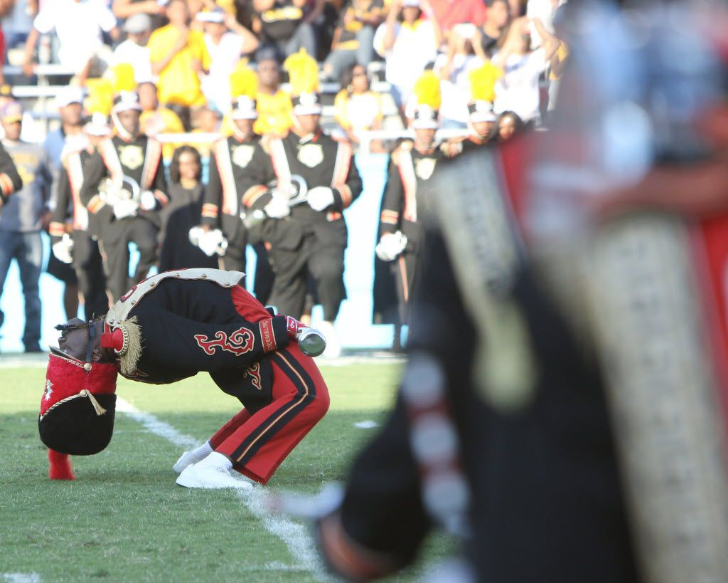 One of the Grambling drum majors bends over backward to the delight of the crowd at the beginning of the school's halftime show in 2015.