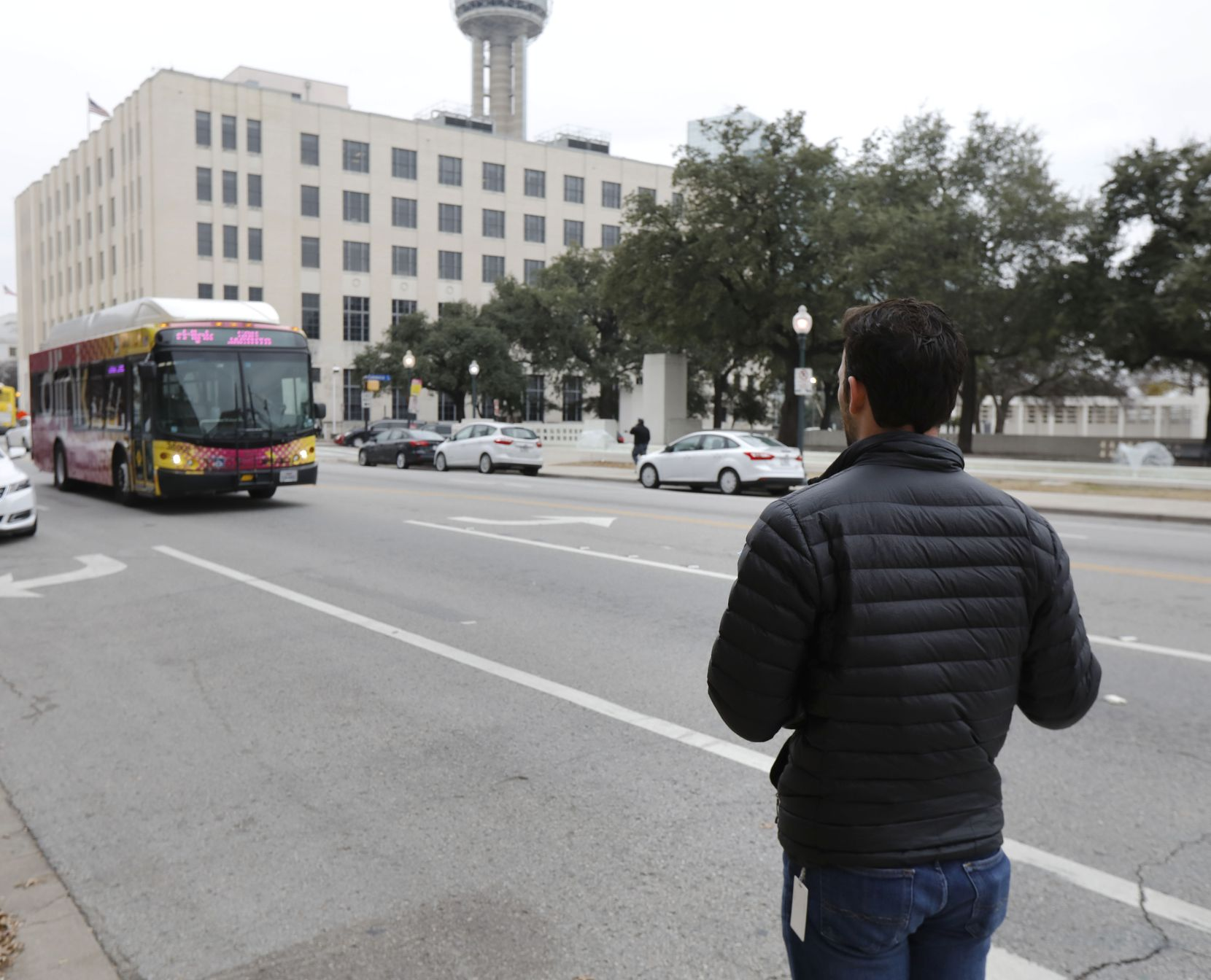 Brendan Meyer waits for a DART bus on Houston St. that passed him by without stopping as he returned to the Dallas Morning News office.