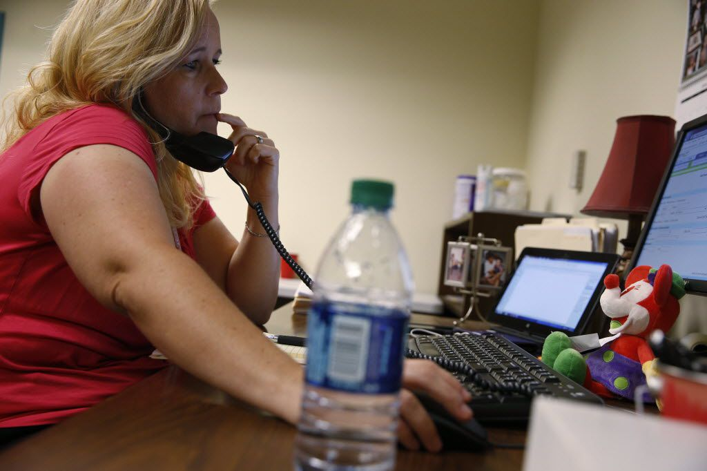 CPS investigator Kelli Bailey of Fort Worth, shown at her office last June. (Nathan Hunsinger/Staff photographer)