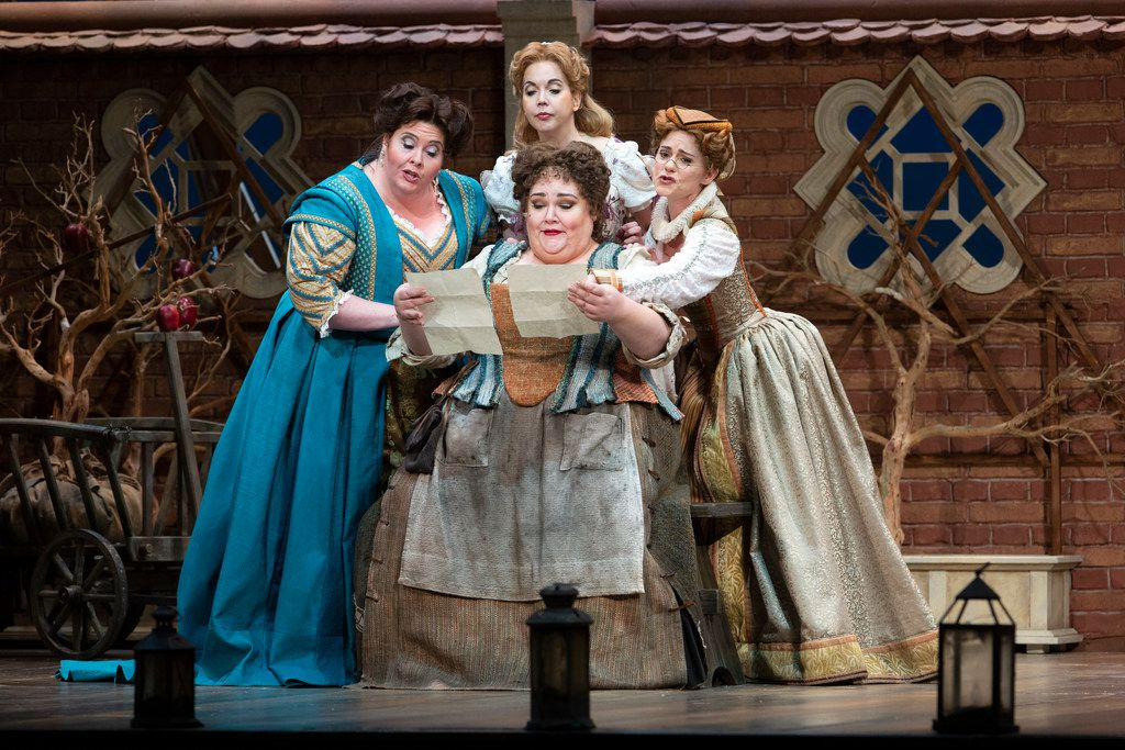 Stephanie Blythe (seated) as Mistress Quickly, with (from left) Angela Meade as Alice Ford, Mojca Erdmann as Nannetta, and Megan Marino as Meg Page perform in the dress rehearsal of the Dallas Opera's Falstaff at the Winspear Opera House.