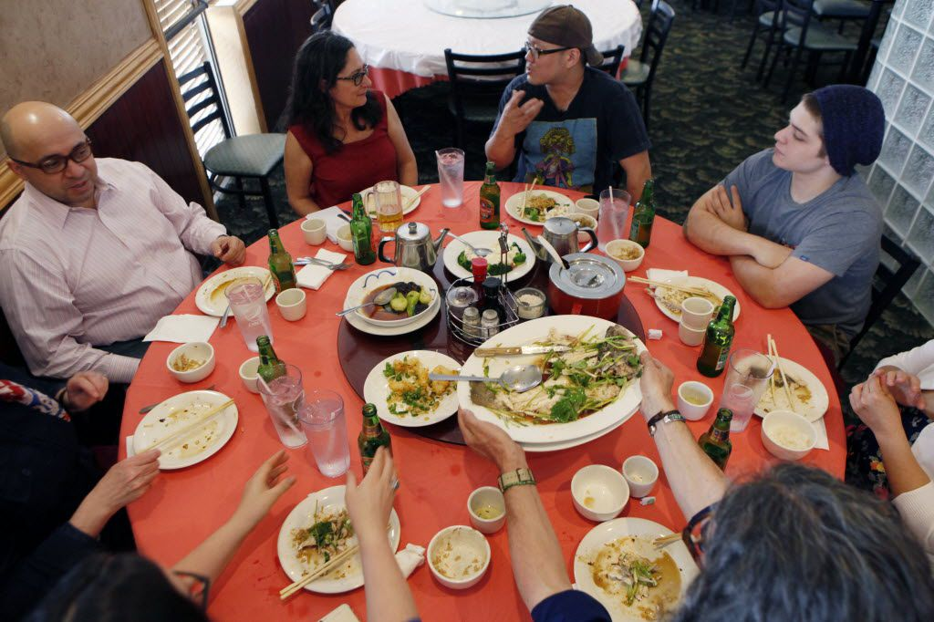 "Chih-Ming ""Petey"" Feng (top right) speaks with restaurant critic Leslie Brenner (top left) while having lunch with friends and colleagues at King Chinese BBQ."