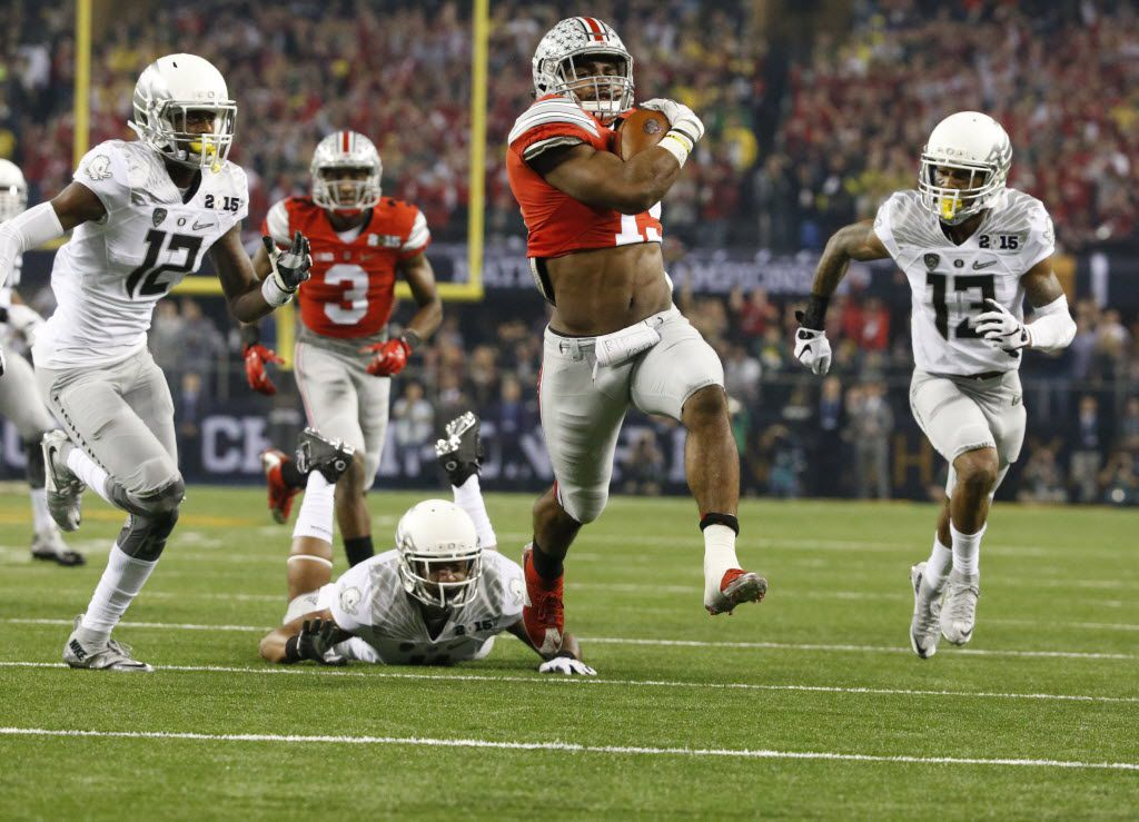 Ohio State Buckeyes running back Ezekiel Elliott (15) runs for a touchdown as they played Oregon during their College Football National Championship Game between Ohio State and Oregon, at AT&T Stadium in Arlington on Monday, January 12, 2015.  (Louis DeLuca/The Dallas Morning News)