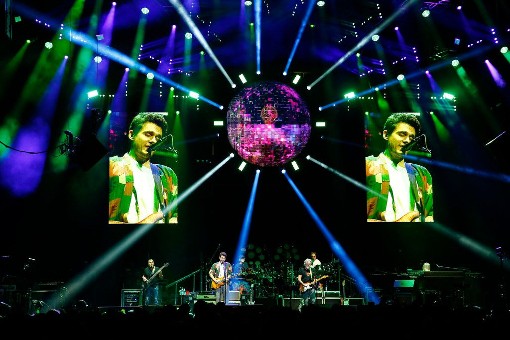 John Mayer (on screen), Bob Weir and others perform with Dead and Company, a Grateful Dead spinoff band, in December 2017 at American Airlines Center in Dallas.