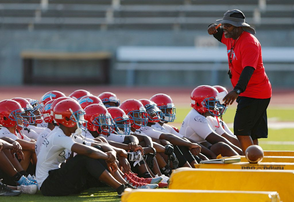 Head football coach Patrick Williams talks to his team during the first day of football practice for Carter High School at Kincaide Stadium in Dallas, on Monday, August 6, 2018. (Vernon Bryant/The Dallas Morning News)