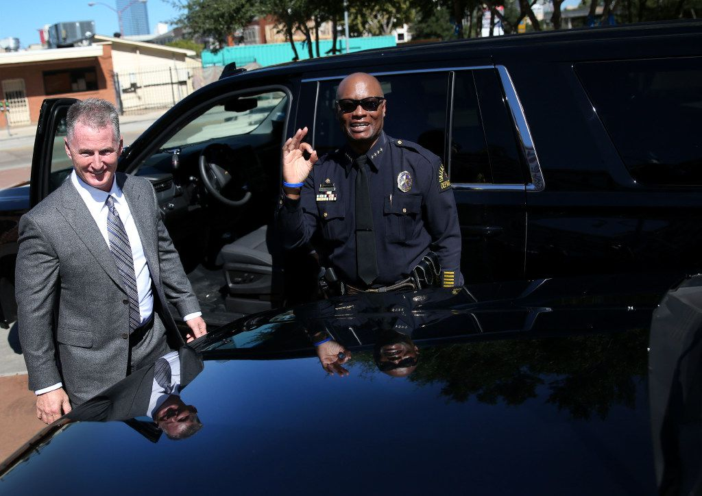 Dallas Police Chief David Brown, with Bobby Baillargeon (left), chairman of the Dallas Fort Worth Metropolitan New Car Dealers Association, accepted a donation that included 14 Chevrolet Tahoes and additional equipment during a news conference at Dallas police headquarters Friday. The donation, which totaled $1 million, was given by the Dallas Fort Worth Metropolitan New Car Dealers Association. (Rose Baca/The Dallas Morning News)
