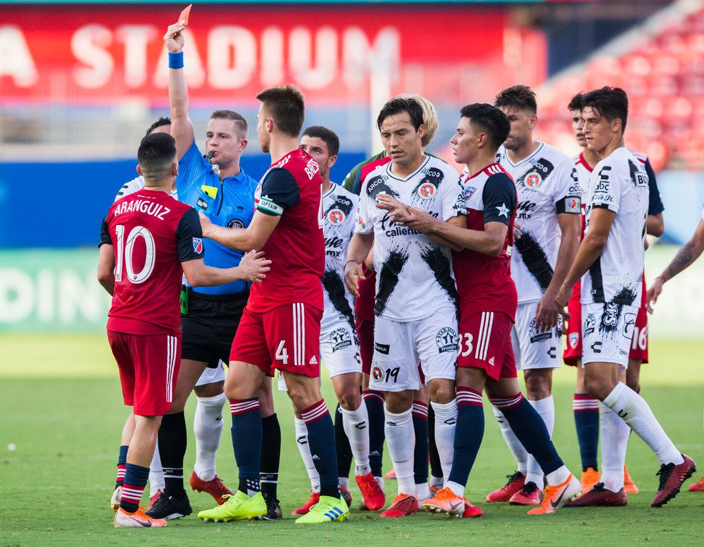 FC Dallas midfielder Pablo Aranguiz (10) gets a red card during the first half of a friendly MLS game between FC Dallas and Club Tijuana on Sunday, July 7, 2019 at Toyota Stadium in Friso. (Ashley Landis/The Dallas Morning News)