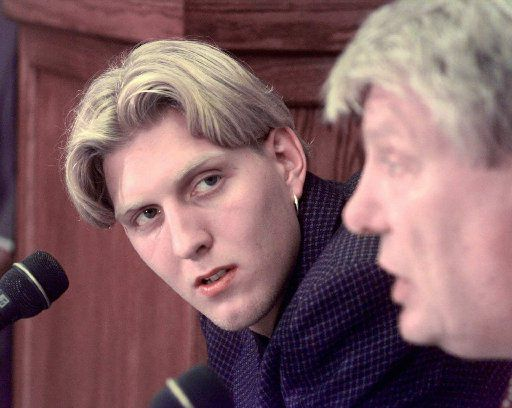 Dallas Mavericks top draft pick Dirk Nowitzki of Germany, listens as coach and general manager Don Nelson speaks during a news conference in Dallas Monday, June 29, 1998. Nowitzki said he will announce his decision Tuesday whether he will play in the NBA next season.