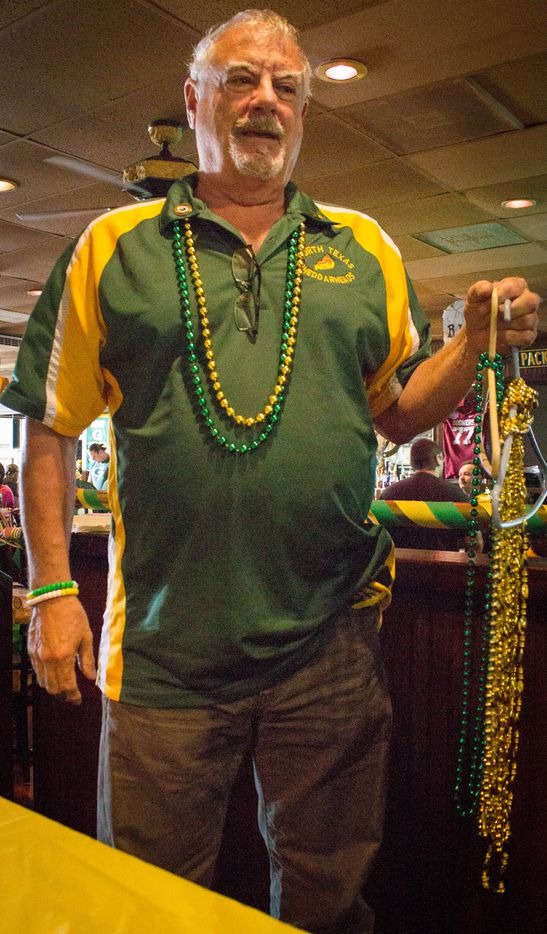 Fans hand out spirit beads on Packers game days at Vernon's Gastropub in Addison.