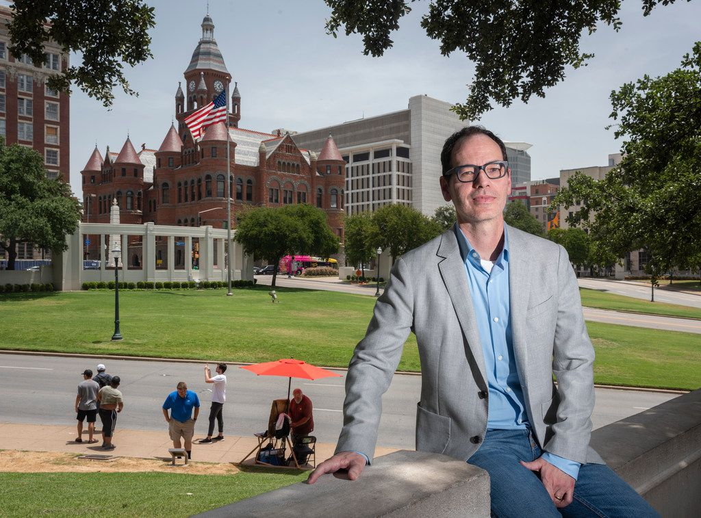 Author Lou Berney near the JFK assassination site in  July.