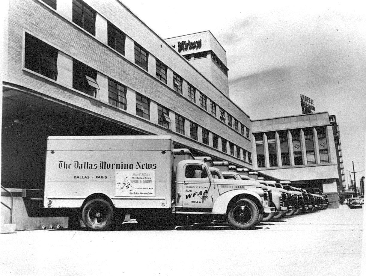 Dallas Morning News delivery trucks on the back dock.