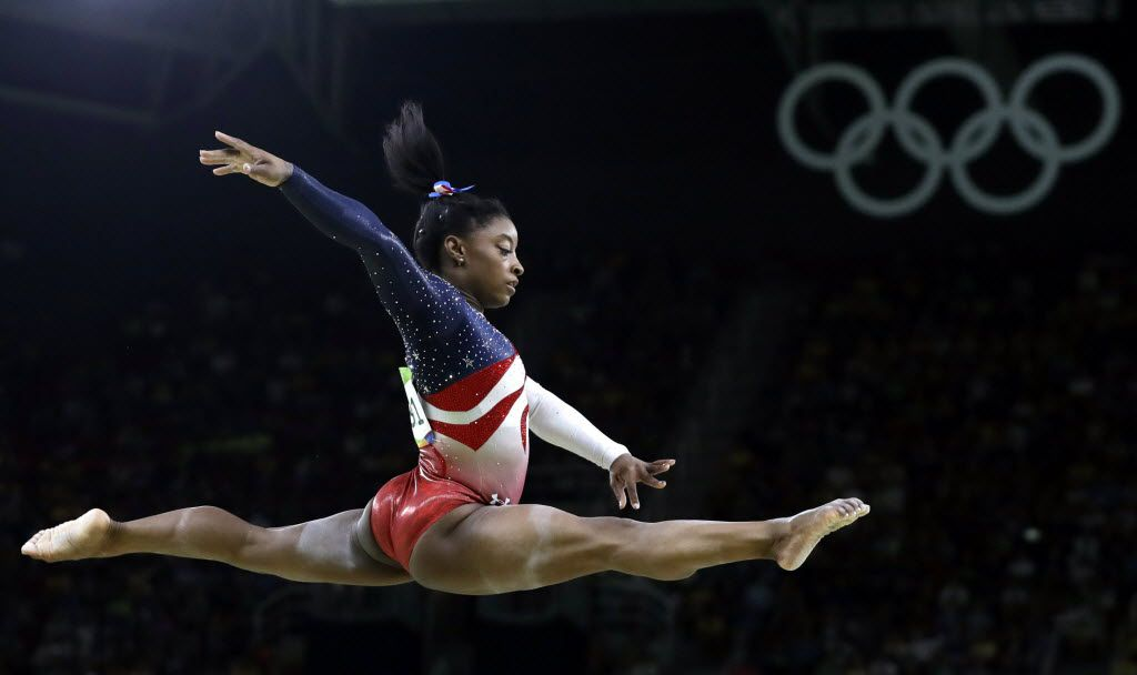 In this Aug. 9, 2016 file photo, United States' Simone Biles performs on the balance beam during the artistic gymnastics women's team final at the Summer Olympics in Rio de Janeiro, Brazil. Many of the Olympics' most memorable moments have come courtesy of African-American women athletes who have accounted for more than a dozen medals in 14 days of competition. (AP Photo/Rebecca Blackwell, File)