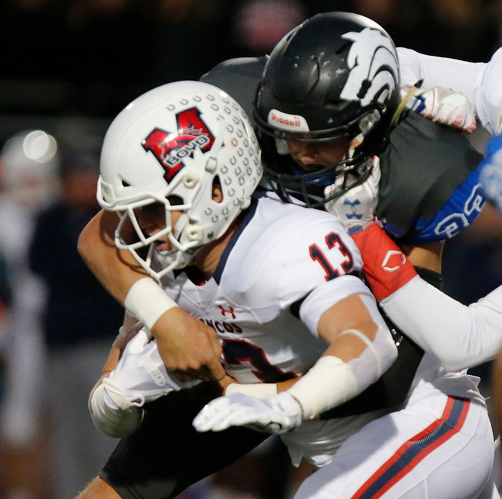 McKinney Boyd High School running back Jake Fex (13) is tackled by Plano West High School linebacker Cole Olmsted (33) on a run up the middle during the first half as Plano West High School hosted McKinney Boyd High School at Clark Stadium in Plano on Friday night, October 11, 2019. (Stewart F. House/Special Contributor)