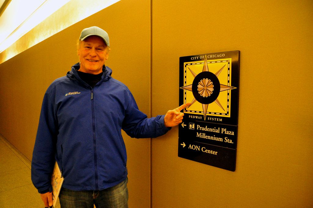 Tour guide Richard Zieman points out Pedway markers used to navigate through the underground network in Chicago.