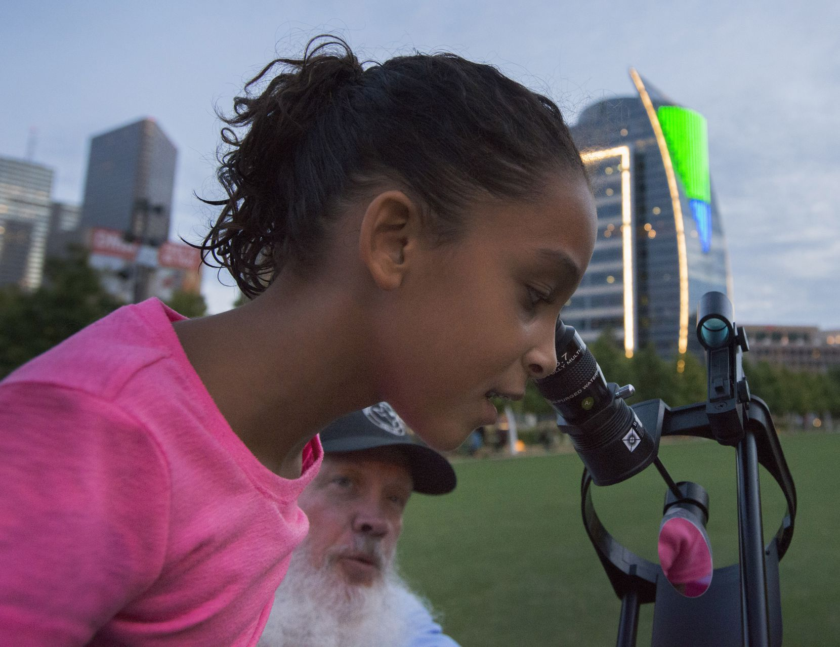 In Sept. 2015, Ariana Guinn, 7, a student at Chester Ditto Elementary School in Arlington, looked at the waxing crescent moon through Dick Gentry'­s telescope from a sidewalk in Klyde Warren Park. Gentry, a member of the Texas Astronomical Society of Dallas was participating in International Observe the Moon Night. International Observe the Moon Night is an annual worldwide public event that encourages observations, appreciation and understanding of our moon and its connection to NASA planetary science and exploration.