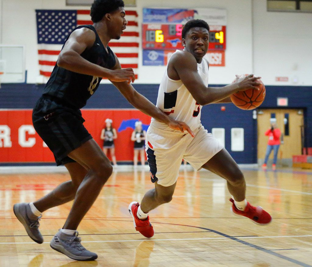 Allen's Isaiah Stevens (3) drives on Wylie's Cam Wells (12) in the first half of their first-round playoff game at Richardson Pearce High School in Richardson, Texas, Monday, February 18, 2019. (Tom Fox/The Dallas Morning News)