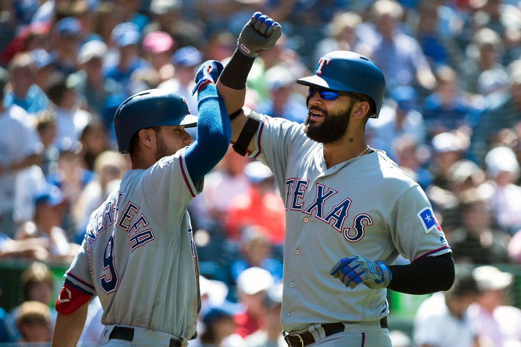 Texas Rangers' Nomar Mazara, right, celebrates his solo home run with teammate Isiah Kiner-Falefa during the seventh inning of a baseball game in Toronto, Wednesday, Aug. 14, 2019. (Nathan Denette/The Canadian Press via AP)