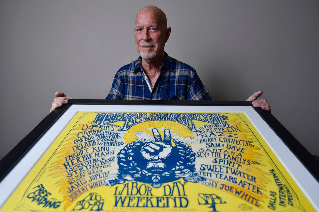 Angus Wynne III with an original poster of the Texas International Pop Festival, which happened 50 years ago.