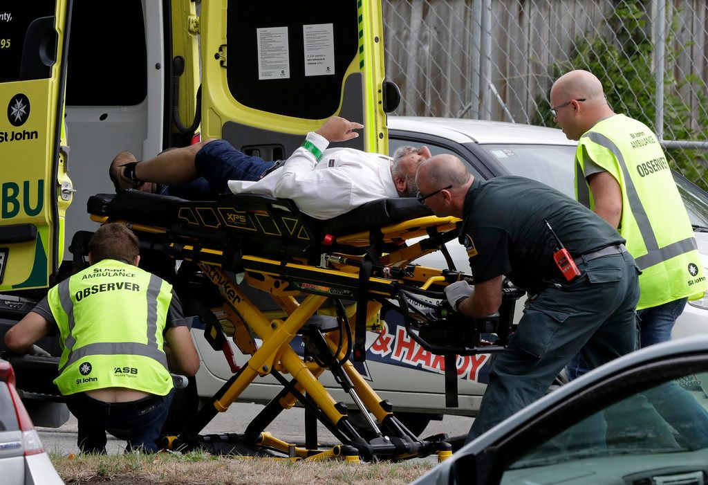 Ambulance staff take a man from outside a mosque in central Christchurch, New Zealand, Friday.