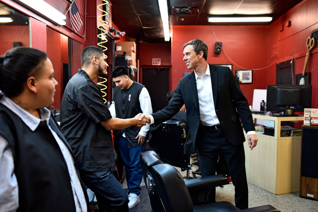 Democratic Senate candidate Beto O'Rourke shakes the hand of barber Ivan Dominguez, 26, of Bishop Barbers as the candidate met with local business owners before conducting a town hall meeting at the Texas Theater in Oak Cliff on Friday, Feb. 23, 2018.