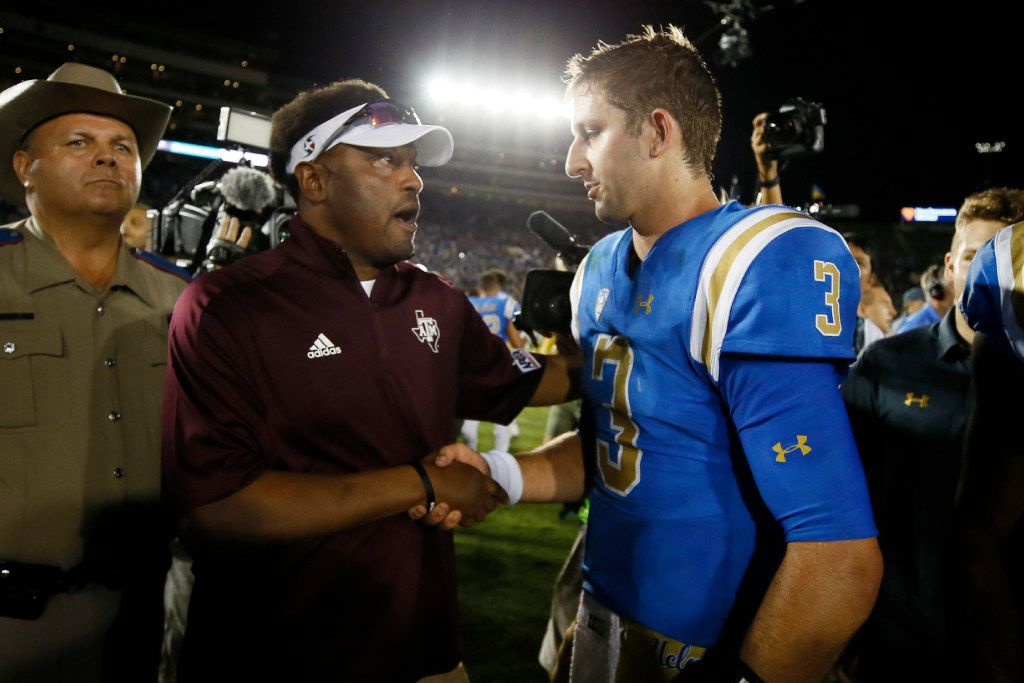 UCLA quarterback Josh Rosen, right, and Texas A&M head coach Kevin Sumlin, left, shake hands after an NCAA college football game, Sunday, Sept. 3, 2017, in Pasadena, Calif. UCLA won 45-44. (AP Photo/Danny Moloshok)